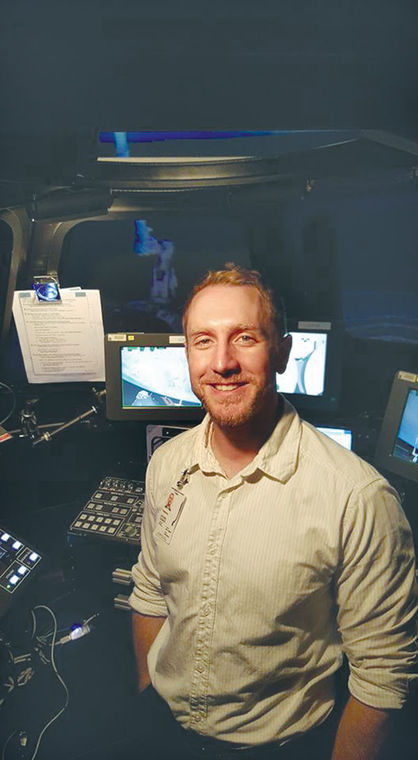 Steven Zusack is shown with a training simulator at the NASA Johnson Space Station in Houston, where he is currently an intern.