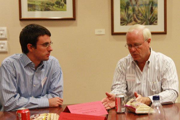 Dr. Kerner talks medicine with a student during a campus visit.