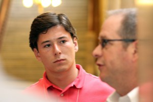 Michael Lumpkin '18 listens to lobbyist Kip Tew at the Indiana Statehouse.