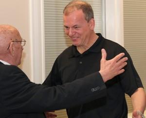 Dan Degryse '83 greets his former advisor and teacher.