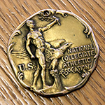 Runner-Up medal won by Raymond Van Arsdale '23 in the broad jump at the 1923 NCAA Track & Field Championships at Stagg Field in Chicago, IL.