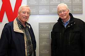 Dick (left) and Tom Van Arsdale pose for a photo of their father's Hall of Fame induction plaque in the Allen Center.