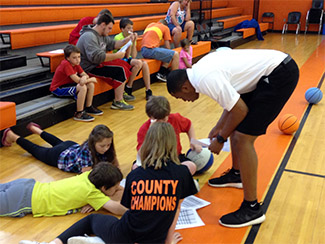 Douglas interacting with children from Eastern Kentucky.