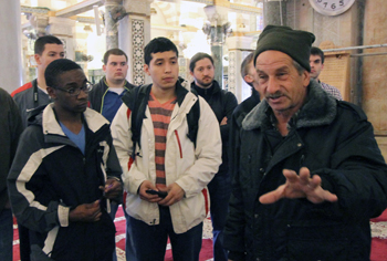 "Tour guide assures students he knows ""all the answers."""