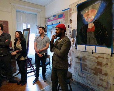 Quinn '00 chats with Wabash art students in his studio.