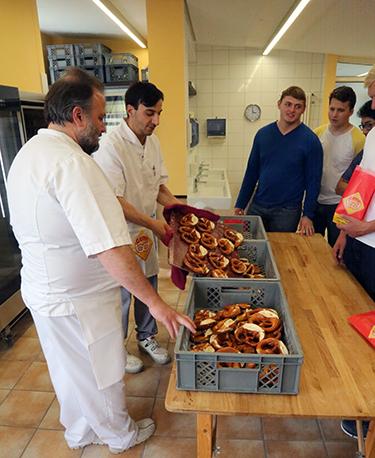 Wabash men learning the art of pretzel making!