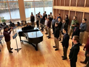 Dan Azar '18 conducts