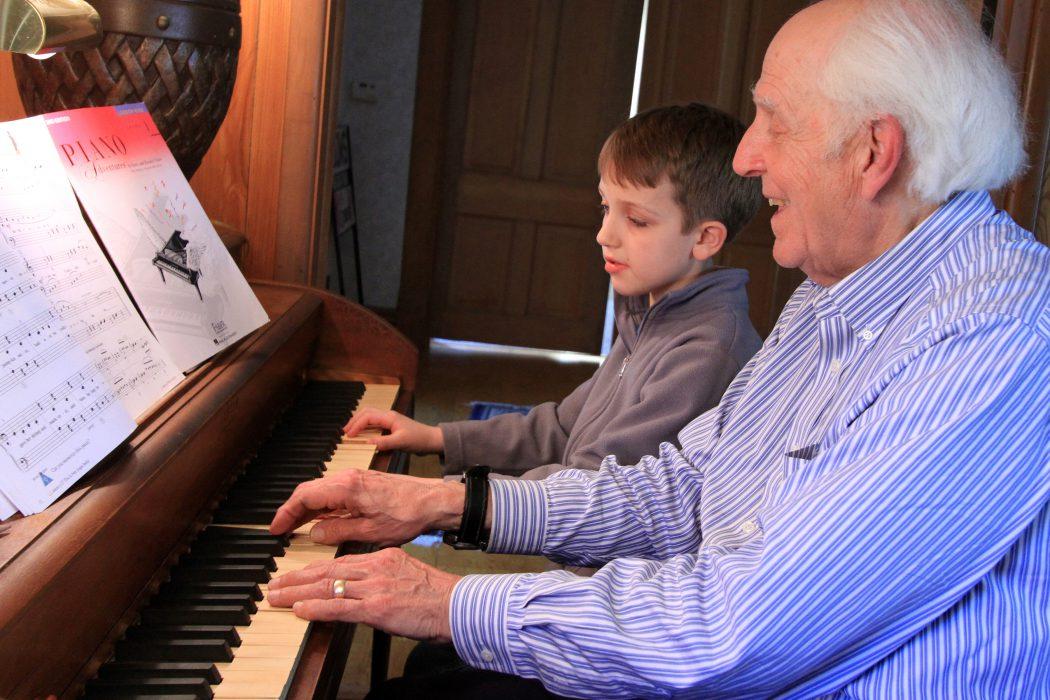 Alan White '60 teaches piano to Myca Garrett.
