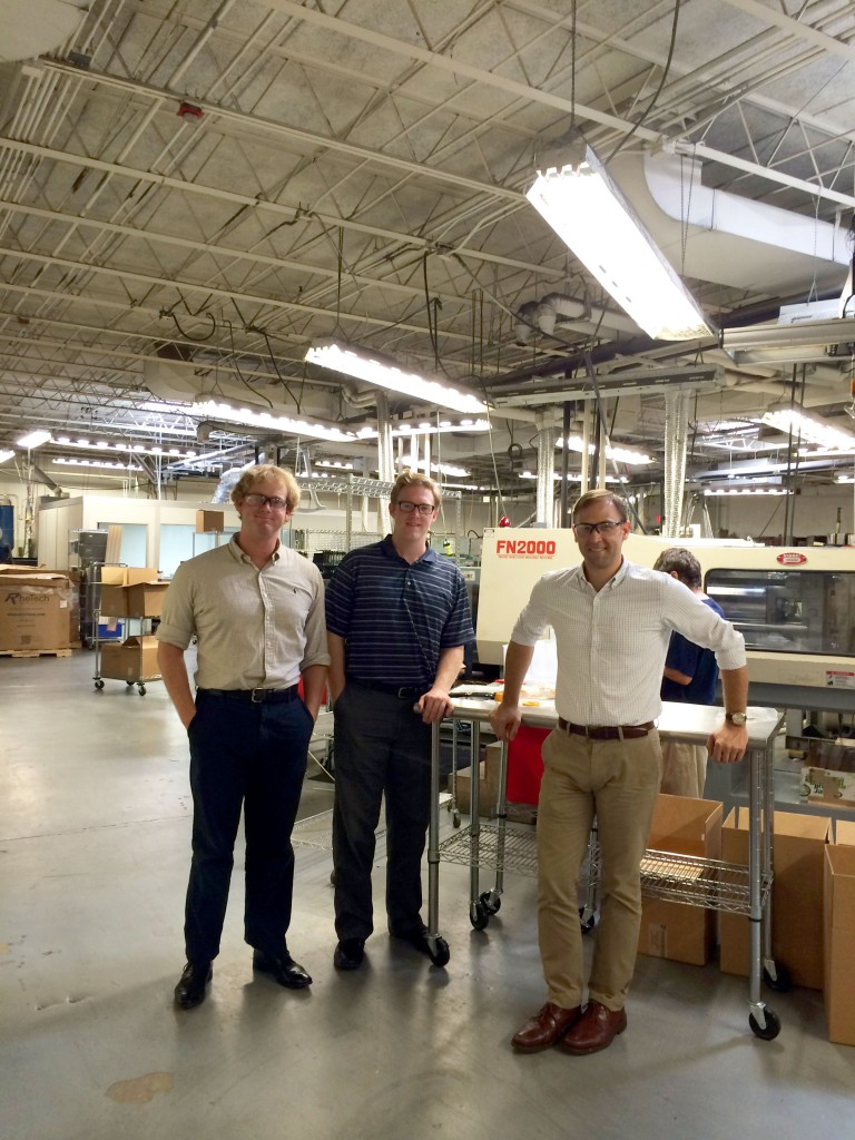 Left to Right: Adam Andrews '12, Stephen Fenton '15, and Andrew Shelton '03 at Paramount in front of their new robotic plastic injection press