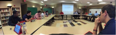 The LABB students sit and listen as Dean Raters explains their upcoming consulting project