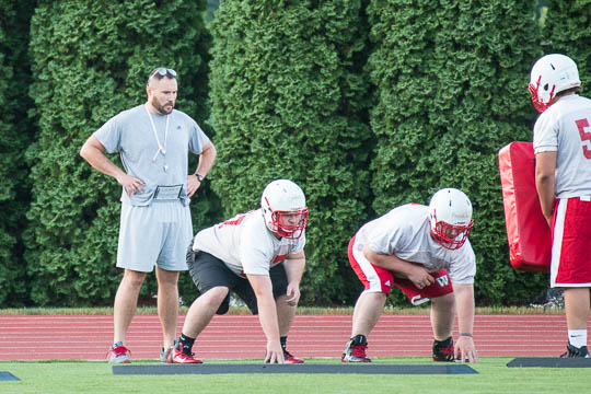 Coach Olmy Olmstead '04 works with new O'Line guys