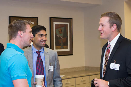 Matt Piechocki '03 talks with Aeknoor Cheema '15 and Tyler Owensby '15