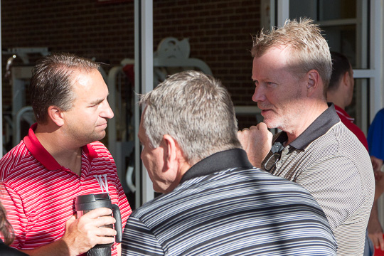 Coach Kyle Brumett talks to a family