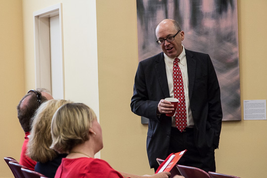 President Hess talks to a set of parents as Dean for Advancement Michelle Janssen looks on.