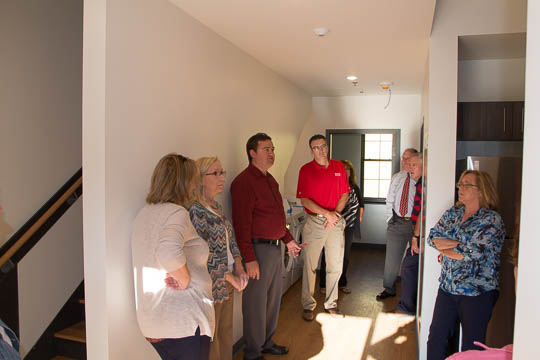 David Morgan, director of Campus Services, gives a tour through the new student housing