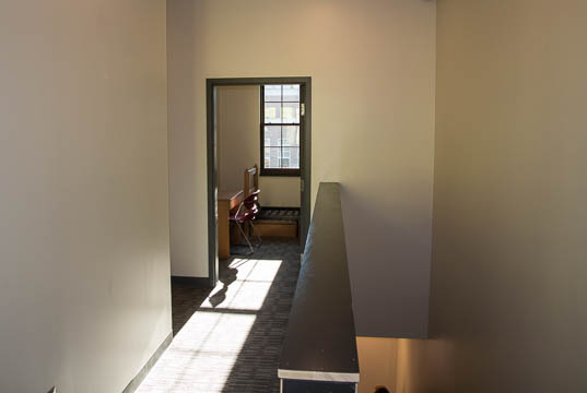 A single person room at the end of the hallway on the second floor.