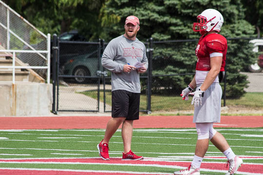 Defensive coordinator BJ Hammer is a constant note taker